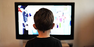 Kid in front of TV